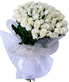 A medium size hand bunch of 50 long stem White Roses.