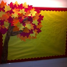 Directions: Brown butcher paper, crumbled it to make the tree bark effect; staple on the bulletin board in the shape of a tree. Cut multiple colors of leaves in fall colors; use a Ellison Dye-cut machine to finish i Seasonal Bulletin Boards, Bulletin Board Tree, November Bulletin Boards, Preschool Bulletin Boards, Classroom Bulletin Boards, Boarders For Bulletin Boards, Classroom Pictures, Classroom Door, Board Decoration