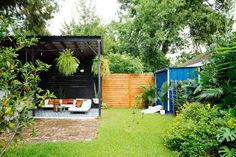 We moved into our New Orleans home three years ago and it's been a really awesome creative journey ever since. I've learned a lot about my style through decorating this home. Here is a tour of our crazy, colorful New Orleans home! Backyard Ideas For Small Yards, Sloped Backyard, Backyard Patio, Decorative Garden Fencing, Wit And Delight, New Orleans Homes, Outdoor Spaces, Outdoor Decor, Outdoor Living