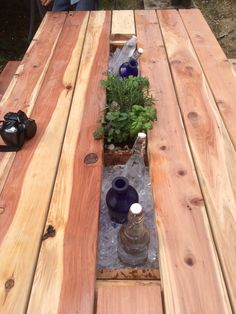 Beautiful handcrafted Redwood Planter and Cooler Picnic Table. Redwood is impervious to weather and bugs do not like it. Pine can also be used Outdoor Wood Table, Deck Table, Outdoor Dining, Outdoor Decor, Diy Picnic Table, Outdoor Picnic Tables, Backyard Picnic, Planter Table, Planters