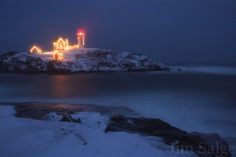 The lights are on at Nubble Lighthouse in York, #Maine!  Photo by Jim Salge Photography!