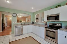 Upgraded Appliances in this Eat in Kitchen in Naples Florida shopnaplesflhomes.com