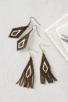 Bead weaving is so much fun, and all you need are beads, a beading needle and beading thread! It also takes a bit of dexterity, but just take it slow and be methodical. Check out the video, in which we show you how to make the entire earring with the brick stitch technique. These earrings are made with beautiful, cylindrical Japanese Toho beads, which are extremely high quality. That means the result will be nice and even. Jewellery Diy, Handmade Jewelry, Beading Needles, Brick Stitch, Bead Weaving, All You Need Is, Corner, Japanese, Drop Earrings