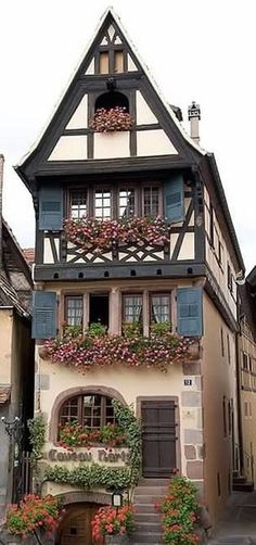 "Traditional Alsatian House Architecture, the ""Caveau Nartz"" Restaurant in Dambach-la-Ville, Alsace - France Places Around The World, Oh The Places You'll Go, Around The Worlds, Beautiful World, Beautiful Homes, Beautiful Places, Ville France, Beautiful Buildings, Old Houses"