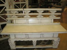 Price: $1395.00  Item #: 124004 Antique, hand carved bench in cream. Measures 59 x 8 x 36T.