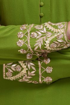 From our Wedding and Bridal Collection, this is a mehandi green pure crepe suit with intricate exquisite gold and rose gold gota patti hand embroidery. The embroidery work on the shirt at sleeve ends and center back. The pure georgette dupatta ha Embroidery Suits Punjabi, Hand Embroidery Dress, Kurti Embroidery Design, Sleeves Designs For Dresses, Dress Neck Designs, Sleeve Designs, Stylish Dresses For Girls, Stylish Dress Designs, Kurta Designs