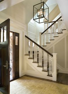 Don't like the craftsman staircase but, like the stair case left of entry.