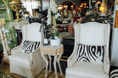 Crisp white arm chairs perfect to add to your living room found at Avery Lane in Scottsdale, Arizona