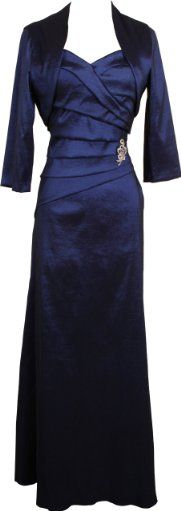Nubby rich two-piece shantung look silky gown in gorgeous jewel tones, with bandage detailing, boned bodice, crystal pin accent, bolero jacket cover up. Fully lined.