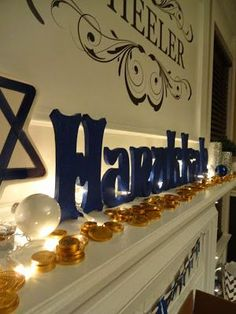 We love this DIY Hanukkah mantel display. Easy to do using wooden letters, acrylic paint, and any embellishments you prefer from your local craft store! #Dreideljams