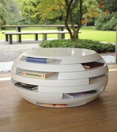 coffee table book storage built from separate discs which can fully rotate disc by asztalos bargu mango wood side table