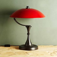 Bleeker Lamp Red, x x 245 GBP - Our take on the traditional library or banker's reading lamp, the Bleecker's metal shade hovers over the gunmetal base on a slender, curved arm. Bedside Table Lamps, Desk Lamp, Room Screen, Soho House, Luxury Lighting, Light Fittings, Lamp Light, Floor Lamp, Mid-century Modern