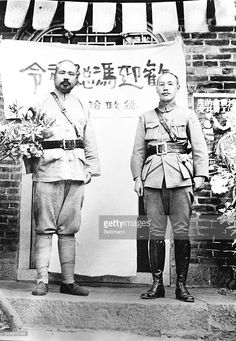 Photo taken at the recent conference between Chiang Kai-shek (R) and Feng Yu-hsiang (L), when the two leading nationalist commanders decided to combine their forces in a drive on Peking for the purpose of dislodging Marshal Chang Tso-lin, Manchurian war-lord, and also to expel Russian Communists from China. The two generals had been stationed on opposite borders of China; this was the first time they had met. Note the contrast in attire -- the Christian general dressed in the older type of…