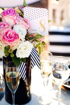 Entertaining: Wedding reception birthday party lunch dinner table setting. Pink and white roses, white & gold embossed place cards, black &white striped ribbon