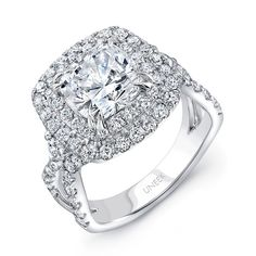 Uneek Cushion-Cut Diamond Pave Double Halo Engagement Ring with Ribbon-Style Shank, in 18K White Gold - Majestic cushion-cut diamond double halo engagement ring in 18K white gold, designed to fit an 8.0 mm center in a double-claw setting, featuring 90 round brilliant cut diamonds (combined weight of 1.60 carats) U-pave set along the cushion-shaped halos, around the gallery, and halfway down the ribbon-like upper shank that is the hallmark of Uneek's Radiance Collection; two of the bigger…