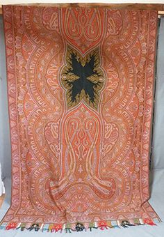 Tightly woven shawl, probably French, with great centre.  Description wool and silk with foliate fronts emerging onto the central black star...