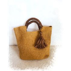 This raffia bag is very stylish and pretty.    I crocheted it with royal raffia yarn that sold in my shop.    It is light and soft. Perfect as a carry