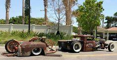 rat with a slammed trailer and full custom bike