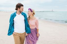 Disneybound Flynn Rider Rapunzel Eugene Disney engagement photos Tangled inspired pictures outfits all at once everything looks different now that i see you beach purple blue clothes flower crown Arielle Peters Photography
