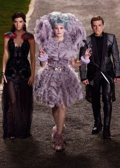 Katniss, Effie Trinket and Peeta in 'The Hunger Games: Catching Fire' (2013). Costume Designer: Trish Summerville