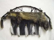 "Cherokee Cross Fox Pelt Quiver with Arrows and Bow 44"". This beautiful full pelt is a Cross Fox. It is a naturally occurring blend of a Silver-Tipped Fox and a Red Fox. This beautiful pelt on black buckskin is a large fringed, wonderfully created artifact. The pelt on these foxes is very thick and luxurious. This piece is handcrafted by Cherokee artist Wet Foot and comes with two arrows and a Certificate of Authenticity.  $389.95"