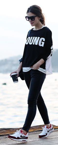 Street style | Casual printed sweater, black skinnies, sneakers. Black sweater women fashion outfit clothing style apparel @roressclothes closet ideas