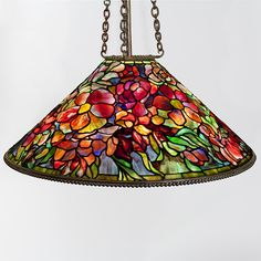 """Tiffany Studios New York """"Bouquet"""" Leaded Chandelier  A Tiffany Studios New York """"Bouquet"""" leaded glass and patinated bronze chandelier. Circa 1900. A similar shade is pictured in: Tiffany Lamps and Metalware: An illustrated reference to over 2000 models, by Alastair Duncan, Woodbridge: Suffolk: Antique Collectors' Club, 1988, p. 216, plate 851. Shade signed: ''Tiffany Studios New York''."""