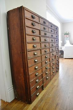 Antique card catalog... a inexpensive version would be an incredible addition to my office!