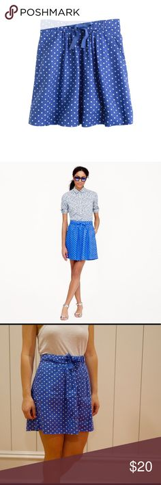 Jcrew Blue Polka Dot Skirt Never been worn blue polka dot skirt. This is a swingy, easy, and unbelievably versatile skirt. Hits above the knee but not quite as short as their mini. Also can be worn at the natural waist. Drawstring skirt. Looks good on every shape and size! J. Crew Skirts