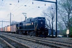 Fresh out of the showroom, Pennsylvania Railroad GE E44-4436 (built 4/62) is leading a freight in Goldsboro, PA on 4-28-62. Pennsylvania Railroad, Showroom, Trains, Diesel, Fresh, Building, Photos, Diesel Fuel, Pictures