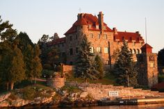 Singer Castle in the world famous 1000 Islands.   Frederick Gilbert Bourne built Singer Castle – or as it was known then – The Towers. The Commodore built the hunting and fishing lodge on Dark Island at the turn of the last century complete with hidden tunnels, secret passageways and a dungeon.   Photographs of the 1000 Islands by Kim Lunman