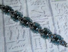 Micro macrame bracelet in gray with teal. by SeaGlassJewelryEtsy