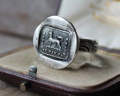 Symbol meaning and history jewelry,handmade by ALM Silver Charms, Sterling Silver Necklaces, Silver Jewelry, Wax Seal Ring, Metal Clay, Wax Seals, Handmade Jewelry, Symbols, Pure Products