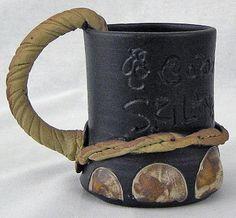elephant paw shaped mug