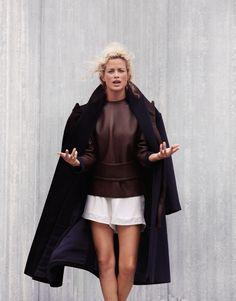black coat, white shorts