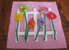 Spring Flowers Fabric Craft  Use fabric scraps to make these beautiful little flowers. The craft sticks make the picket fence.       * colorful fabric scraps      * large piece of pink felt(construction paper is ok, too)      * 7 craft sticks(Popcicle sticks)      * green pipe cleaners      * scissors      * glue