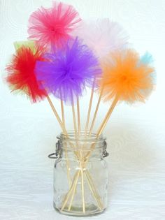 pom poms~ tulle. I made these (well not these in the pic) but pink and gray, for a birthday party.  They was great