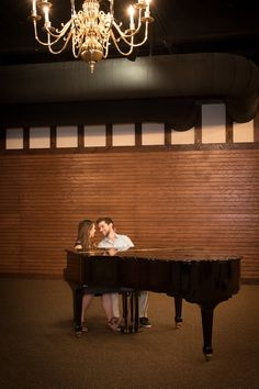 Engagement photo session with a classic romantic piano pose. by Awakened Light Photography, Michigan.
