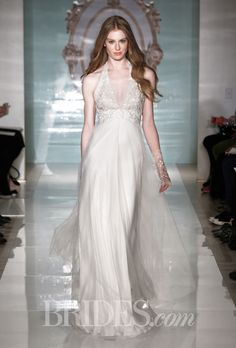 Brides.com: . Ivory and blush tulle A-line wedding dress with an embroidered halter neckline, Reem Acra