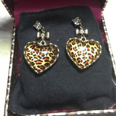 Betsey johnson leopard heart rhinestone earrings Set in Yellow gold platting, 2inch leopard print heart earrings accented with bows and a rhinestone. Brand new, never been worn. Betsey Johnson Jewelry Earrings