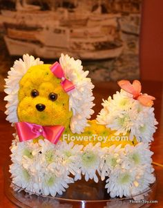 This Shih Tzu Doggy arrangement is made of fresh flowers and looks like your favorite toy.