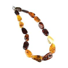 """""""Majestic 26 Inches Amber Necklace Item No. AM00093A01 $648.89 This majestic amber necklace was masterfully hand-created by Russian artisans with the most intriguing authentic amber. The largest amber cabochon measures Approximately 1-3/4"""" in length, and the smallest measures about - 1/4"""" in length. The necklace string is knotted in between each stone. There are 17 amber stones total, each with their own unique beauty, containing natural cracks, grooves, roughness, and inclusions. Amber Necklace, Amber Jewelry, Beaded Necklace, Pendant Necklace, Amber Stone, Baltic Amber, Artisan, Stones, Natural"""