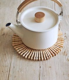 Whip up a Scandinavian-style table protector from–get this–wooden clothespins and floral wire.