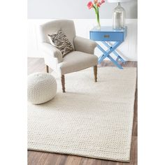Inspired by traditional hand-knitting, the thick strands of luxurious New Zealand wool are braided together to create this unique cable area rug. The pattern is centuries old and features natural thick-core yarns that complement modern interiors.