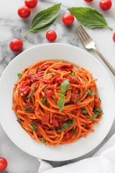 I'm a huge pasta eater. Examples supporting this fact can easily be found in this simple spaghetti fra diavolo, my famous one-pan cacio e pepe, and this outrageously easy veggie fajita pasta. I love them all! But my favorite pasta of all time…? It might just be this simple, saucy, tomato basil pasta. I mean…...