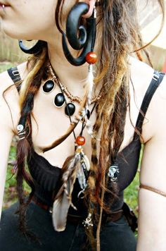 punk, hippie gauges are way too big, but otherwise that that I love her dreads and outfit