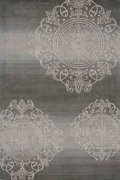 A beautiful transitional design graces this unique piece. Hand-tufted of 100% mod-acrylic, featuring a heavy wash that gives this rug a beautiful sheen.