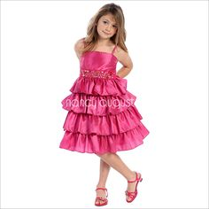 Fantastic Four Layer Fuchsia Flower Girl Dress With Beaded Waistband: This fantastic four layer fuchsia flower girl dress is perfect for any little girl looking to arrive in style this season. The dazzling thick rhinestone and beaded waistline is a perfect compliment to the cute and sassy layered skirt. The fuchsia pink dress would not only be a perfect flower girl dress for a black tie wedding but can also be a great party dress.