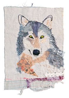 Mandy Pattullo, Grey Wolf, 2013. 30 x 21cm (12 x 8in). Long and short stitches, over the collaged areas, follow the direction of the fur growth.
