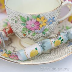 Vintage tea cup and saucer to hire with vintage tea cracker favour by www.fuschiadesigns.co.uk.